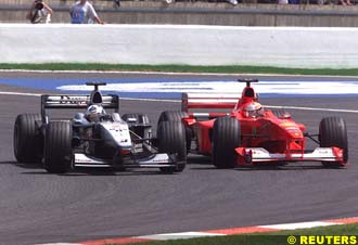 Coulthard gets past Michael Schumacher
