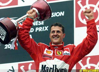 Schumacher celebrates the win and the Championship