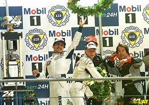 McNish, Stephane Ortelli and Laurent Aiello (Porsche) after finishing in 1st at the 98 Le Mans