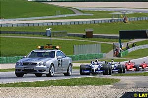 The pace car leading the pack around