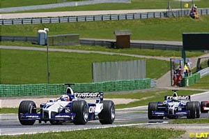 Juan Pablo Montoya leading teammate Ralf Schumacher in early parts of the race