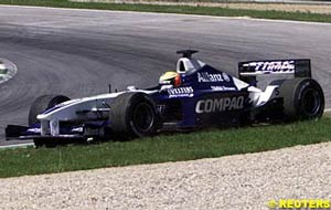 Ralf Schumacher on the grass with brake troubles