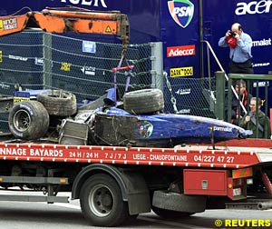 The wreckage of Luciano Burti's Prost AP04 on it's way back to the garage