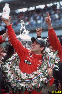 Winner Castroneves with the famous bottle of milk