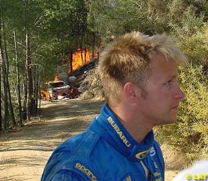 Solberg walks away from his burning Impreza