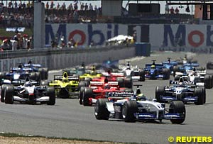 Ralf Schumacher takes the lead into the first corner