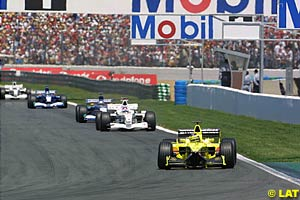 Heinz Harald Frentzen with Jacques Villeneuve following in the background
