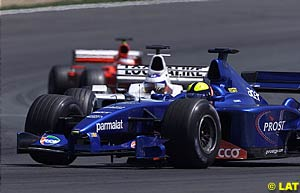 Luciano Burti followed by Olivier Panis and Rubens Barrichello