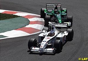 Olivier Panis leads Eddie Irvine