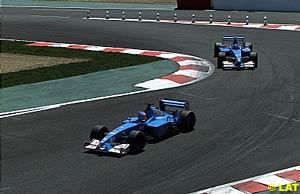 Jenson Button in front of Giancarlo Fisichella
