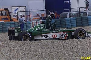 Eddie Irvine in the gravel at turn 1