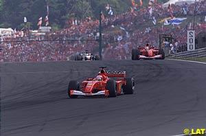 Michael Schumacher followed by Rubens Barrichello and David Coulthard