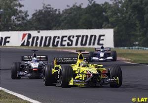 Jarno Trulli leads Mika Hakkinen