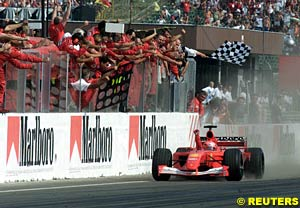 Michael Schumacher takes the flag as winner of the 2001 Hungarian Grand Prix