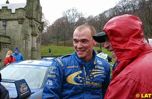 2001 World Rally Champion Richard Burns is congratulated by his father after completing the final stage