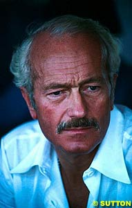 Lotus's Colin Chapman, part of the committee that presented proposals to the FISA that required unanimous approval. The FISA teams dissented, and so the proposals were rejected