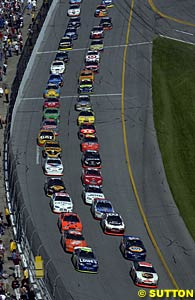 Dale Jarrett and Jimmie Johnson lead the field away at the start
