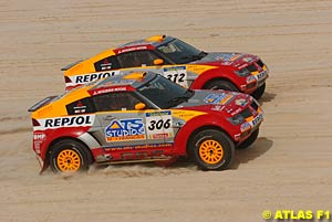 Mitsubishi's first and second place finishers run side by side on the last stage